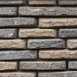 Stacked stone wall face